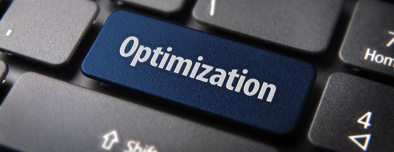 Blue key with Optimization word on laptop keyboard