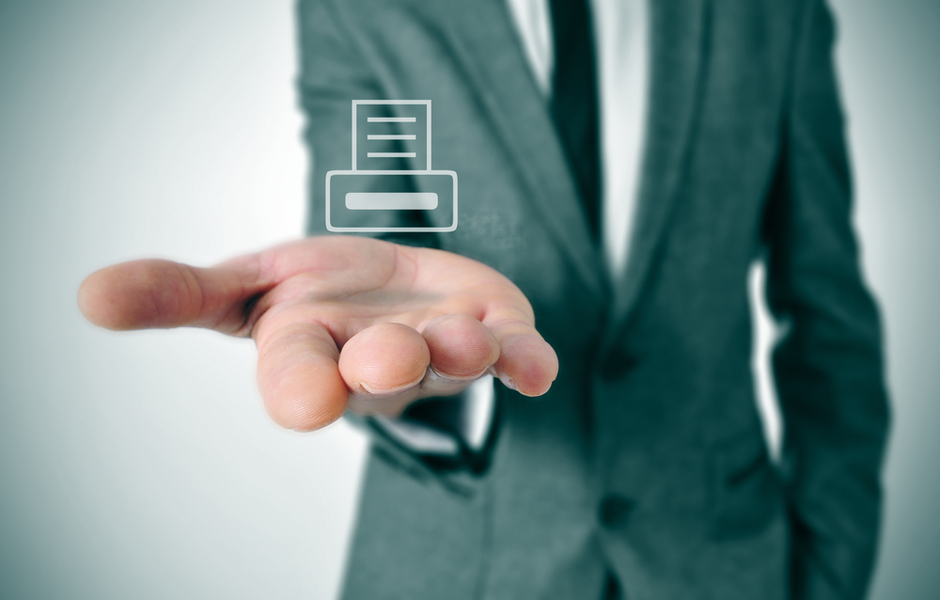 printer icon hovering over business man hand